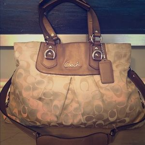 Coach, tan signature satchel with leather trim.